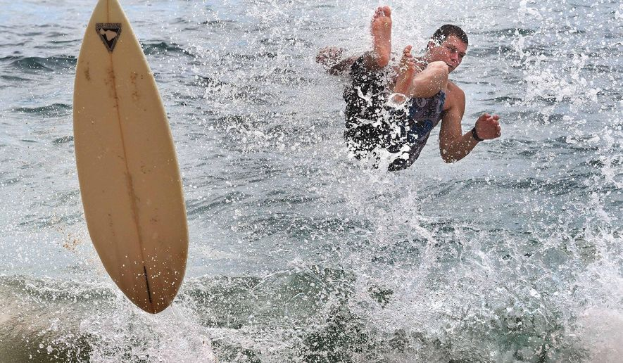 ADVANCE FOR SUNDAY, JUNE 7, 2015 AND THEREAFTER  - In this May 30, 2015 photo, Joe Mannoia falls while skimboarding at Big Beach at Makena State Park at Kihei on the island of Maui in Hawaii. An ocean safety brochure in every hotel, condominium, classroom and beach rental shack has been a longtime dream for many Maui County officials. (Matt Thayer/The News via AP)