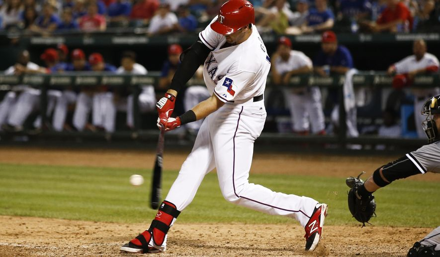 Texas Rangers' Joey Gallo connects for a single against the Chicago White Sox during the eighth inning of a baseball game Thursday, June 4, 2015, in Arlington, Texas. (AP Photo/Jim Cowsert)