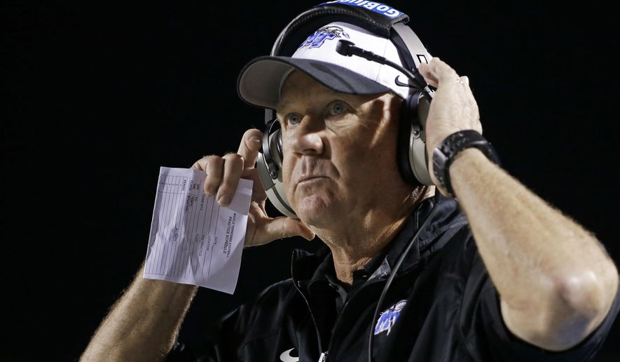 FILE - In this Sept. 13, 2014, file photo, Middle Tennessee head coach Rick Stockstill watches from the sideline during the fourth quarter in an NCAA college football game against Western Kentucky in Murfreesboro, Tenn. Stockstill has agreed to postpone the $100,000 pay raise he earned until January 2019 at a cost of $400,000 to his pocket. The coach says he restructured his contract to help Middle Tennessee better handle paying the cost of attendance to student athletes (AP Photo/Mark Humphrey, File)