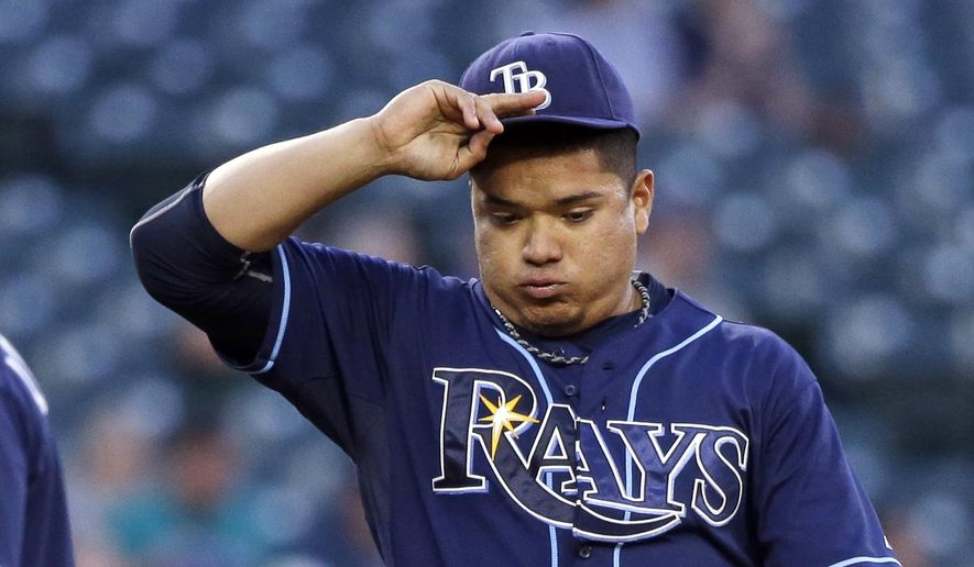 Tampa Bay Rays starting pitcher Erasmo Ramirez lets out a breath after giving up a hit to the Seattle Mariners in the fifth inning of a baseball game Thursday, June 4, 2015, in Seattle. (AP Photo/Elaine Thompson)