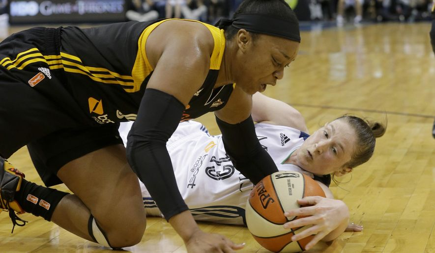 Tulsa Shock guard Odyssey Sims, left, and Minnesota Lynx guard Lindsay Whalen, right, battle for a loose ball during the first half of a WNBA basketball game in Minneapolis, Friday, June 5, 2015. (AP Photo/Ann Heisenfelt)