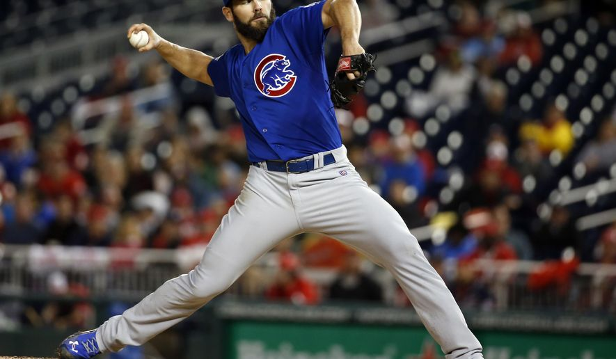Chicago Cubs starting pitcher Jake Arrieta throws during the fourth inning of a baseball game against the Washington Nationals at Nationals Park, Thursday, June 4, 2015, in Washington. (AP Photo/Alex Brandon)