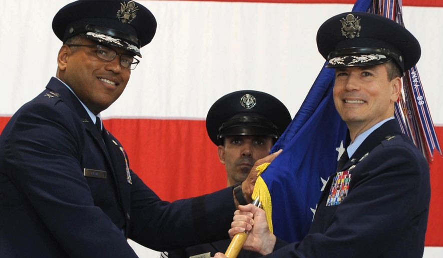 In this photo provided by the U.S. Air Force, Brig. Gen. Paul W. Tibbets IV, right, receives the the 509th Bomb Wing guidon from Air Force Maj. Gen. Richard Clark, left, to take over leadership of the United States' aging fleet of nuclear-capable B-2 stealth bombers June 5, 2015 at Whiteman Air Force Base, Mo. Tibbets, a grandson and namesake of the man who piloted the B-29 that dropped the atomic bomb on Hiroshima, replaces Brig. Gen. Glen VanHerck, who has led the wing since February 2014.  (Staff Sgt. Alexandra M. Longfellow/U.S. Air Force via AP)