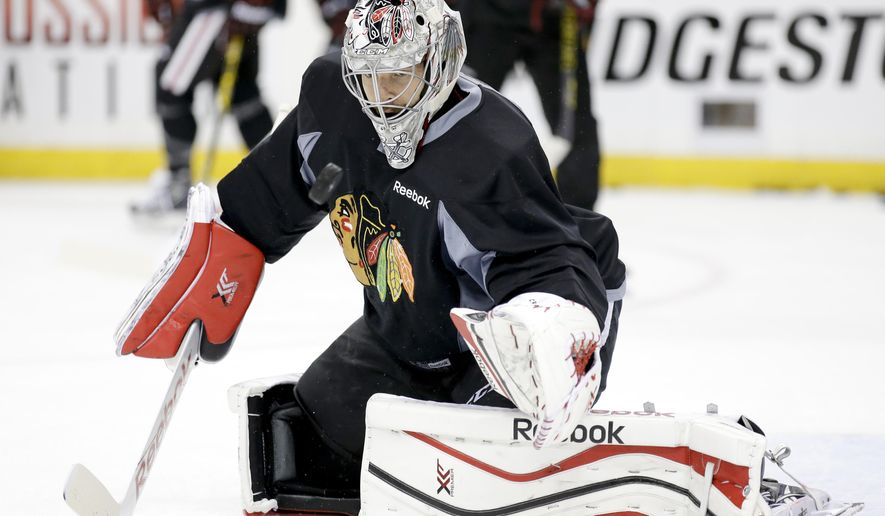 Chicago Blackhawks goalie Corey Crawford blocks a shot during practice at the NHL hockey Stanley Cup Final, Friday, June 5, 2015, in Tampa, Fla. The Chicago Blackhawks lead the best-of-seven games series against the Tampa Bay Lightning 1-0. Game 2 is scheduled for Saturday night. (AP Photo/Chris Carlson)