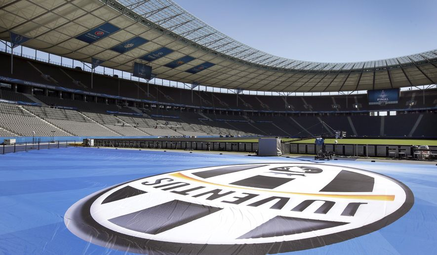 A giant logo of Juventus Turin is placed in front of the supporters stand at the Olympic stadium in Berlin, Germany, Friday, June 5, 2015, one day before the soccer Champions League final between Juventus Turin and FC Barcelona. (AP Photo/Michael Sohn)