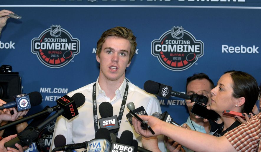 Connor McDavid, the OHL's Player of the Year and number one pick in the upcoming 2015 NHL Draft, pauses when he is asked about all the media attention he is getting during a news conference at the NHL Combine Friday, June 5, 2015, in Buffalo, N.Y. (AP Photo/Gary Wiepert)