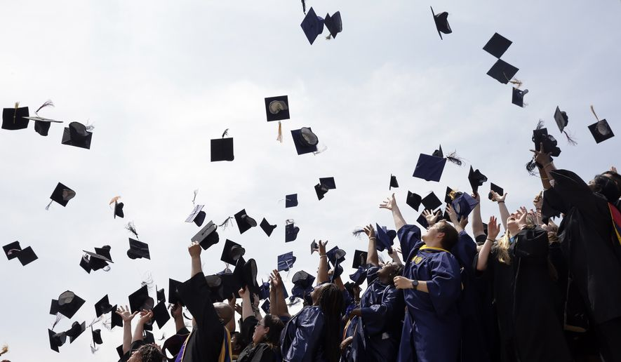 Newly minted local college graduates take part in the annual Toss Your Caps class photo Friday, May 8, 2015, on the steps of the Philadelphia Museum of Art in Philadelphia. (AP Photo/Matt Rourke) **FILE**