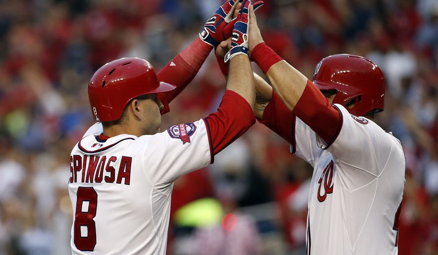 Washington Nationals' Danny Espinosa (8) celebrates with Wilson Ramos (40) after Espinosa knocked Ramos in as part of his three-run homer during the second inning of a baseball game against the Chicago Cubs at Nationals Park, Friday, June 5, 2015, in Washington. The Nationals won 7-5. (AP Photo/Alex Brandon)