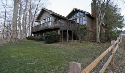 FILE - In this March 18, 2015 file photo, the home of John Hinckley's mother in the Kingsmill resort in Williamsburg, Va. A federal judge is deciding whether to allow Hinckley to live full-time outside St. Elizabeths, the mental hospital that has been his home since he was found not guilty by reason of insanity in the 1981 shooting that wounded Reagan and three others. Hinckley has spent longer stretches of time on the outside in recent years, staying at his mother's home in Williamsburg, Virginia, where the hospital says he's ready to live full-time. Prosecutors have pushed for tight restrictions including wearing an ankle bracelet, a requirement the judge has dismissed in the past.  (AP Photo/ Steve Helber, File)