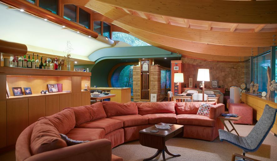 Curved laminated beams create a flowing ceiling in the the centerpiece room designed in 1997 by architect Robert Harvey Oshatz and built in 2004 on a steep lot in Portland's West Hills. For his client, a music lover, Oshatz orchestrated a modern, wood-and-glass house that has a curving, cedar ceiling and other acoustic-enhancing shapes and materials. More than amphitheater-quality sound, however, the Wilkinson residence, in a forested part of Southwest Portland, artfully blends two fields: Architecture and music.  (Randy L. Rasmussen/The Oregonian via AP)