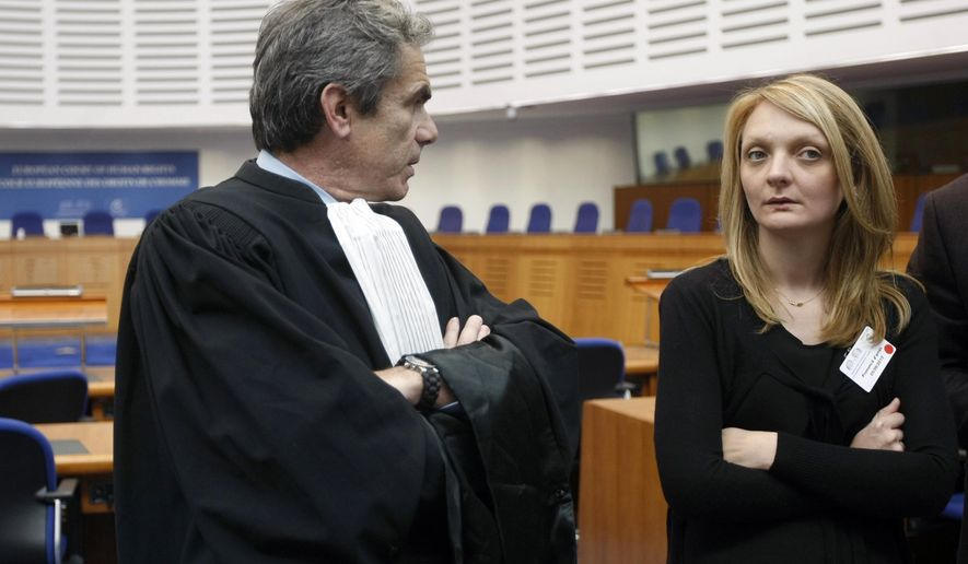 Rachel Lambert, wife of Vincent Lambert, a Frenchman who has been comatose for seven years, attends with her lawyer  Laurent Petiti a verdict about her husband in the European Court of Human Rights in Strasbourg, eastern France, Friday, June 5, 2015. Europe's top human rights court has allowed doctors to stop treatment of a French man left comatose after a car accident seven years ago, a case that has drawn nationwide attention amid debate about end-of-life practices. Lambert's family members disagree on whether to keep him alive artificially. His wife wants doctors to stop life support for him but his parents disagree. (AP Photo/Christian Lutz)