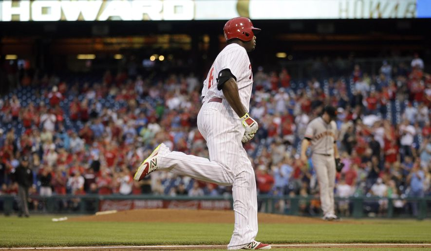 Philadelphia Phillies' Ryan Howard, left, rounds the bases after hitting a two-run home run off San Francisco Giants starting pitcher Tim Lincecum, right, during the first inning of a baseball game, Friday, June 5, 2015, in Philadelphia. (AP Photo/Matt Slocum)