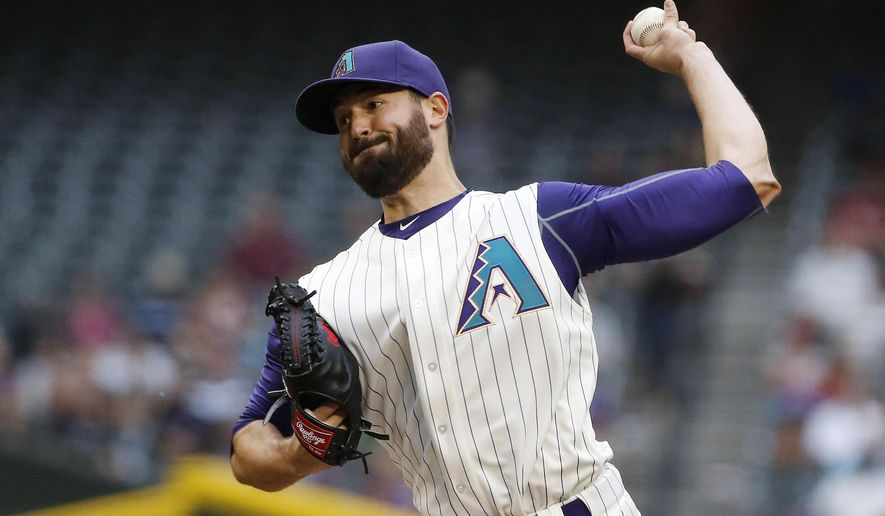 Arizona Diamondbacks' Robbie Ray throws a pitch to the New York Mets during the first inning of a baseball game Thursday, June 4, 2015, in Phoenix. (AP Photo/Ross D. Franklin)