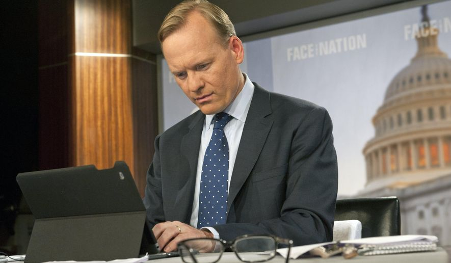 """In this June 3, 2015 photo released by CBS, John Dickerson prepares for his first broadcast as moderator of  """"Face The Nation,"""" in Washington. Dickerson replaces Bob Schieffer after 24 years as host of the political program. (Chris Usher/CBS via AP)"""