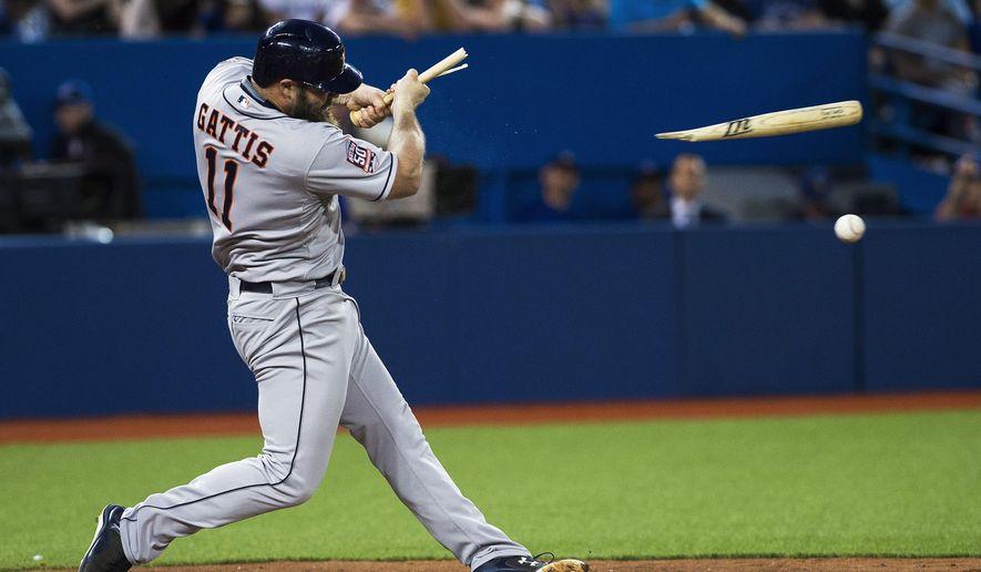 Houston Astros' Evan Gattis breaks his bat against the Toronto Blue Jays during the seventh inning of a baseball game, Friday, June 5, 2015 in Toronto. (Aaron Vincent Elkaim /The Canadian Press via AP) MANDATORY CREDIT