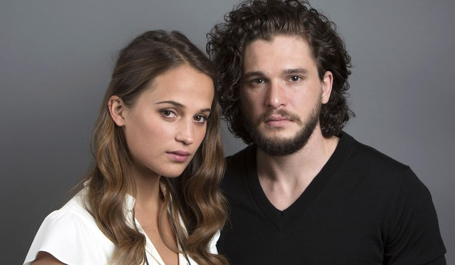 """Testament of Youth"" actors Kit Harington and Alicia Vikander pose for a portrait on Wednesday, June 3, 2015 in New York. (Photo by Amy Sussman/Invision/AP)"