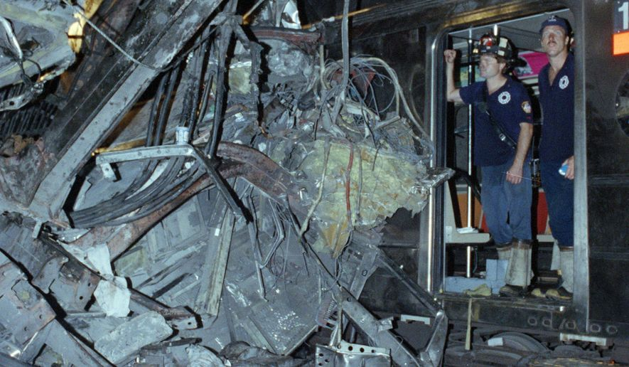 FILE - In this Aug. 28, 1991, file photo, firemen look at the twisted remains of a downtown Lexington Avenue 4 subway train after its derailment at Union Square in New York. Far removed from an era when New Yorkers knew him as the drunken motorman in a nightmarish subway crash, Robert Ray once again found himself in a miserable situation. This time, Ray was the victim, mowed down by a hit-and-run driver as he tried to cross a busy thoroughfare in the Bronx on May 28, 2015. (AP Photo/File)