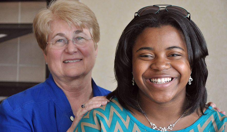 ADVANCE FOR SUNDAY, JUNE 7, 2015 - Joined by Linda Strojan, left, an Aiken High School guidance counselor, Leanne Summers poses for a photo in Aiken, S.C, in early June, 2015. Summers will graduate on Friday, June 5, as the fourth-ranked senior in her class, heading to the University of North Carolina with prestigious scholarships to study pharmacy. (Rob Novit/The Aiken Standard via AP)