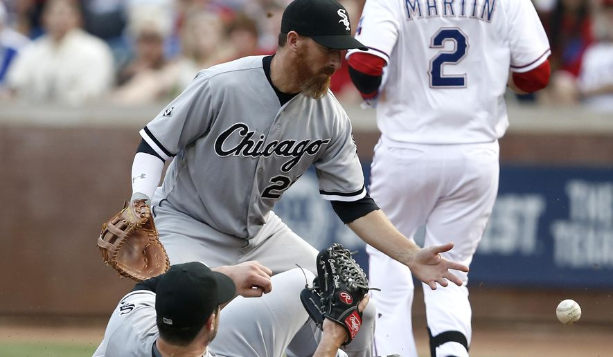 Chicago White Sox starting pitcher Carlos Rodon, bottom, and first baseman Adam LaRoche, top left, are unable to make a play on a bunt single by Texas Rangers' Leonys Martin (2) during the second inning of a baseball game Thursday, June 4, 2015, in Arlington, Texas. (AP Photo/Jim Cowsert)