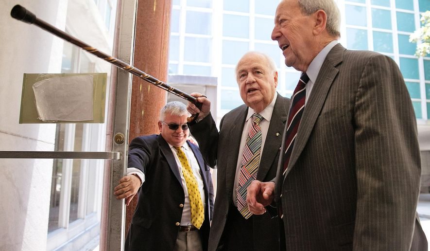 """This cane is just for show,"" joked New Orleans Saints, Pelicans owner Tom Benson as he leaves Civil Court in New Orleans for lunch following a morning of testimony in his competency trial Friday, June 5, 2015.  (Ted Jackson/NOLA.com The Times-Picayune via AP)"