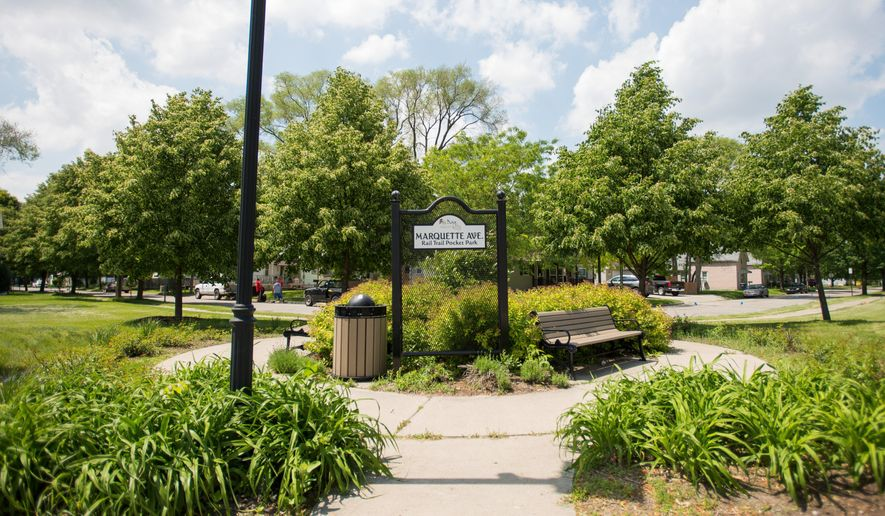 This June 4 2015 photo shows the entrance at the Marquette Ave. Rail Trail Pocket Park in Bay City, Mich. The Bay City Commission voted to rename Marquette Pocket Park the Michael A. Cathcart Memorial Park. A dedication ceremony is July 3. Sgt. 1st Class Michael A. Cathcart died of wounds received from small arms fire in Kunduz Province on Nov. 14. (Amanda Ray/The Bay City Times via AP) LOCAL TELEVISION OUT; LOCAL INTERNET OUT