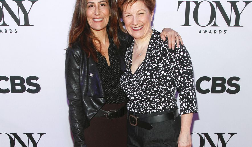 "FILE - In this April 29, 2015, file photo, Jeanine Tesori, left, and Lisa Kron, from ""Fun Home,"" attend the 2015 Tony Awards Meet the Nominees press junket in New York. Tesori and Kron can make history when the Tony awards are announced on Sunday, June 7, 2015. If they win, the pair will become the first female writing team to nab a Tony for best musical score. (Photo by Andy Kropa/Invision/AP, File)"