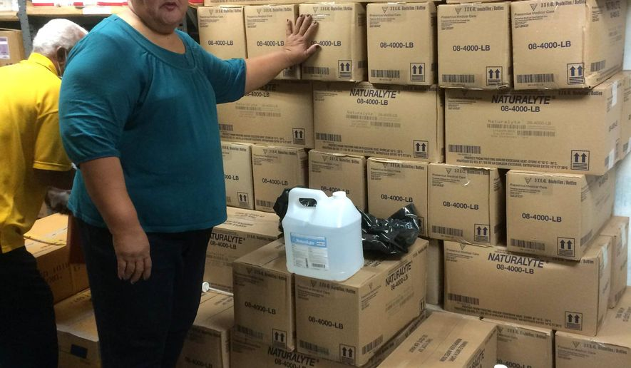 This June 3, 2015 photo provided by the Samoa News shows Dialysis Head Nurse Olita Tafiti in the storage room where liquid bicarbonate concentrate is stored at the LBJ Medical Center in the U.S. territory of American Samoa. A fresh supply of a dialysis product needed for the treatment of renal failure was expected to be delivered to American Samoa on Friday, June 5 after a recall forced the only hospital on the island to stop treatments. (Joyetter Feagaimaalii-Luamanu/Samoa News via AP)