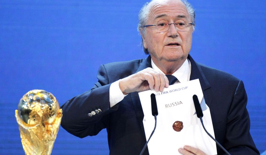 FILE - In this Thursday, Dec. 2, 2010 file photo, FIFA President Sepp Blatter announces Russia to host the 2018 World Cup during the announcement of the host country for the 2018 soccer World Cup in Zurich, Switzerland. FIFA has been plunged into crisis since seven officials were arrested in dawn raids last week at a luxury Zurich hotel and in a separate probe, Swiss authorities are investigating the 2018 and 2022 World Cup bidding contests, which went to Russia and Qatar. (AP Photo/Michael Probst, File)