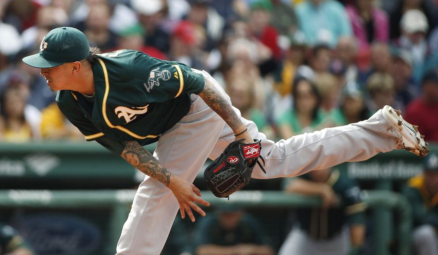 Oakland Athletics' Jesse Chavez pitches during the first inning of a baseball game against the Boston Red Sox in Boston, Saturday, June 6, 2015. (AP Photo/Michael Dwyer)