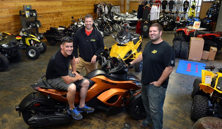 ADVANCE FOR SUNDAY JUNE 7 AND THEREAFTER CRAIG This Friday May 22, 2015 photo shows the Frame brothers -- Cameron, left, Stephen, center,  and Trey who recently opened Hidden Trails Motorsports near Appalachian Power Park in Charleston, W.Va. After opening their first store in Shrewsbury, W.Va., in eastern Kanawha County, the Frames say they saw a niche in Charleston for power sports vehicles motorcycles, ATVs and personal watercraft that needed to be filled. (Craig Cunningham/Charleston Daily Mail via AP)