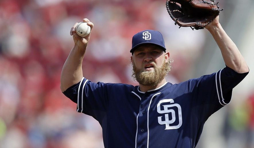 San Diego Padres starting pitcher Andrew Cashner stretches after giving up three runs in the first inning of a baseball game against the Cincinnati Reds, Saturday, June 6, 2015, in Cincinnati. (AP Photo/John Minchillo)