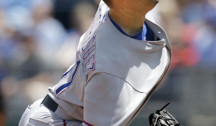 Texas Rangers starting pitcher Wandy Rodriguez delivers to a Kansas City Royals batter during the first inning of a baseball game at Kauffman Stadium in Kansas City, Mo., Saturday, June 6, 2015. (AP Photo/Orlin Wagner)