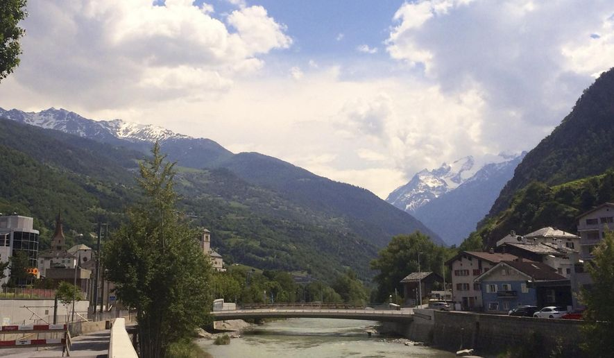 The river Vispa flows through the town of Visp, Switzerland, where FIFA President Sepp Blatter grew up, in this photo dated Thursday June 4, 2015.  Blatter, who has become embroiled in the FIFA corruption scandal and recently announced that he would resign as president, often returns to the picture-postcard town of his youth and where his daughter and son-in-law still live. (AP Photo/Daniella Matar)