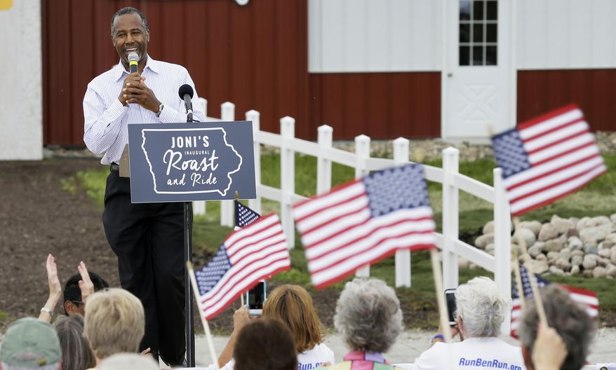 Republican presidential candidate Ben Carson is greeted by supporters during a fundraiser for U.S. Sen. Joni Ernst, R-Iowa, Saturday, June 6, 2015, in Boone, Iowa. (AP Photo/Charlie Neibergall) ** FILE **
