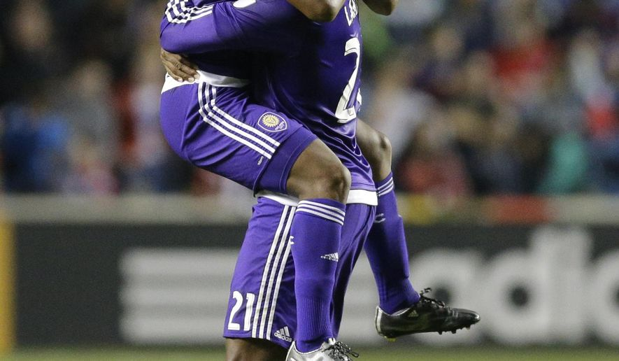 Orlando City SC forward Cyle Larin, right, celebrates with midfielder Cristian Higuita after they defeated the Chicago Fire 3-2 in an MLS soccer game on Saturday, June 6, 2015, in Bridgeview, Ill. (AP Photo/Nam Y. Huh)