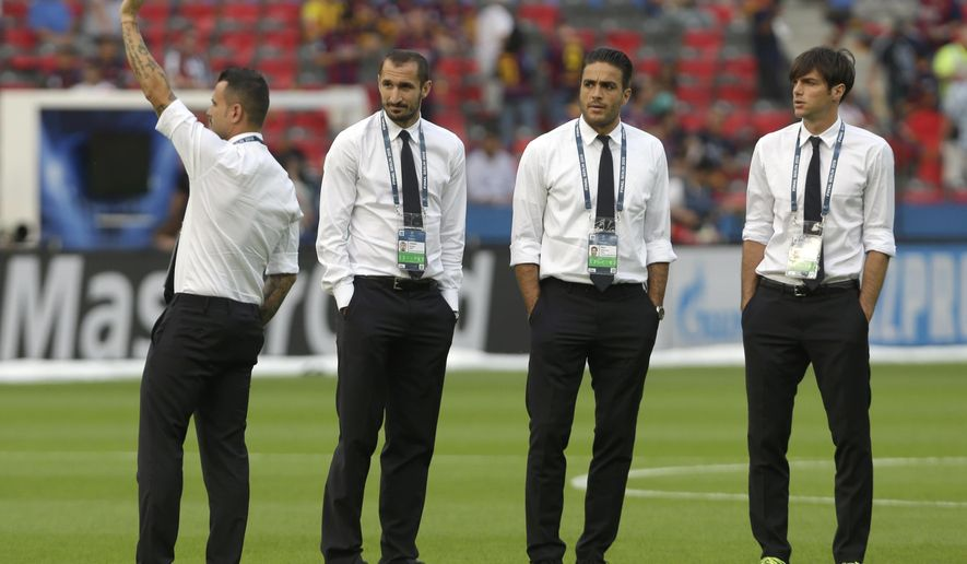 Juventus' Giorgio Chiellini, second left, stands with his teammates before the Champions League final soccer match between Juventus Turin and FC Barcelona at the Olympic stadium in Berlin Saturday, June 6, 2015. Giorgio Chiellini is injured and will not play in the final. (AP Photo/Luca Bruno)