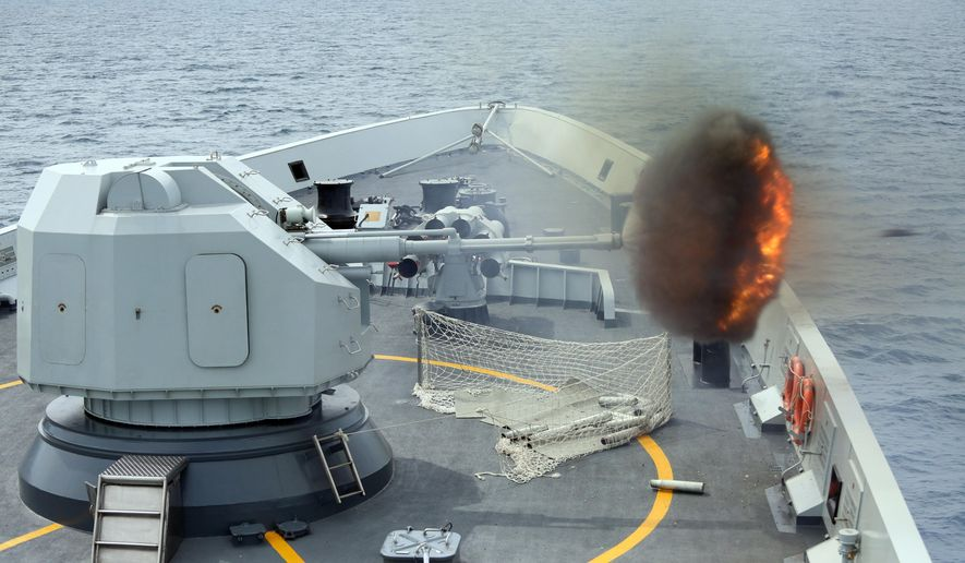 "An anti-surface gunnery is fired from China's Navy missile frigate Yulin during the ""Exercise Maritime Cooperation"" by Singapore and Chinese navies in the South China Sea, May 24, 2015. (Bao Xuelin/Xinua via AP, File) ** FILE **"