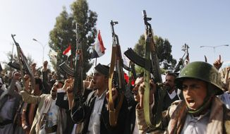 FILE - In this April 16, 2015, file photo, Shiite rebels, known as Houthis, chant slogans during a demonstration against an arms embargo imposed by the U.N. Security Council on Houthi leaders, in Sanaa, Yemen. Saudi Arabia shot down a Scud missile early Saturday, June 6, 2015,  fired into the Sunni kingdom by Yemen's Shiite rebels and their allies, the country's official news agency reported, marking what could be a major escalation in the monthslong war. A Patriot missile battery shot down the Scud around 2:45 a.m. Saturday around the southwestern city of Khamis Mushait, the official Saudi Press Agency reported. The agency blamed Shiite rebels, known as Houthis, and their allies in forces loyal to former Yemeni President Ali Abdullah Saleh. (AP Photo/Hani Mohammed, File)