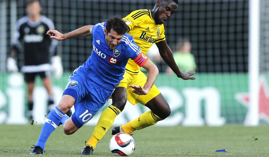 Columbus Crew midfielder Tony Tchani (6) tries to keep the ball from Montreal Impact midfielder Ignacio Piatti (10) during the first half of a soccer match, Saturday, June 6, 2015 in Columbus, Ohio. (Eli Hiller/The Columbus Dispatch via AP)