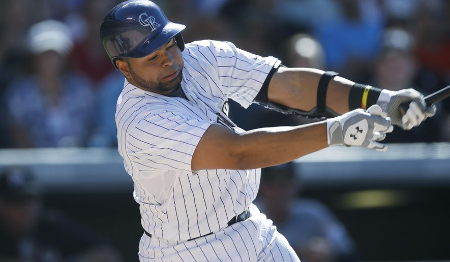Colorado Rockies' Wilin Rosario connects for a solo home run off Miami Marlins relief pitcher Andre Rienzo in the fourth inning of a baseball game Saturday, June 6, 2015, in Denver. (AP Photo/David Zalubowski)