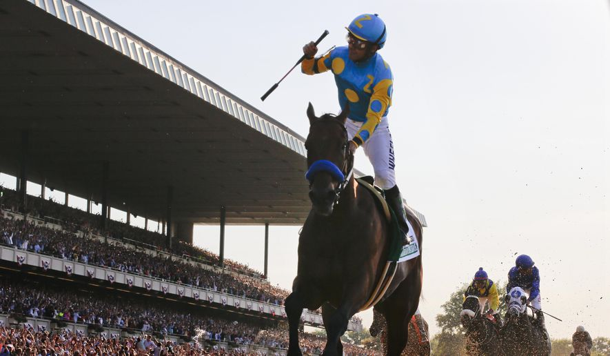 Victor Espinoza reacts after crossing the finish line with American Pharoah (5) to win the 147th running of the Belmont Stakes horse race at Belmont Park, Saturday, June 6, 2015, in Elmont, N.Y. American Pharoah is the first horse to win the Triple Crown since Affirmed won it in 1978.  (AP Photo/Julio Cortez)