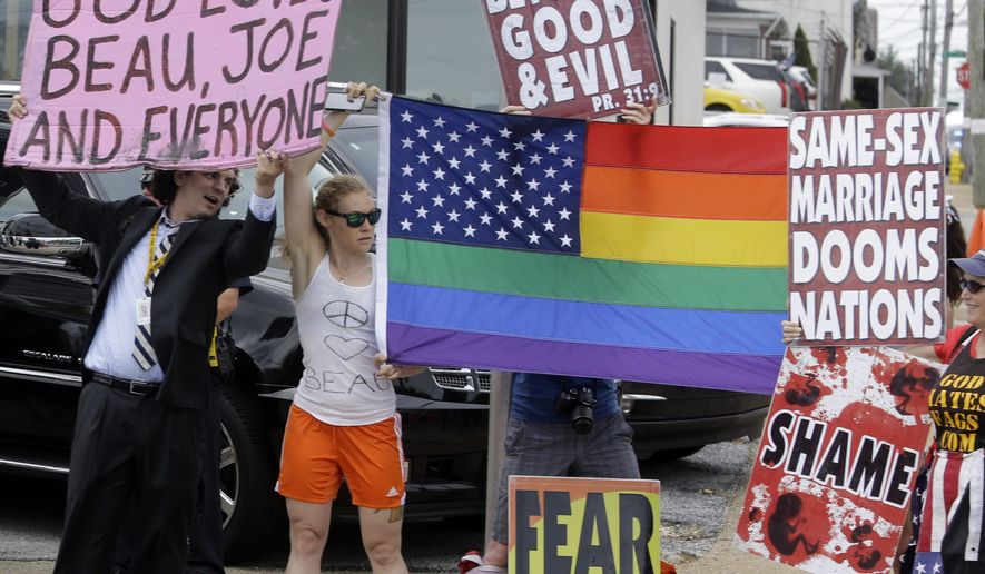Counter protestors try to block the signs of members of the Westboro Baptist Church as the motorcade carrying President Obama travels through Wilmington, Del. to the funeral of former Delaware Attorney General Beau Biden, June 6, 2015. (Associated Press) ** FILE **