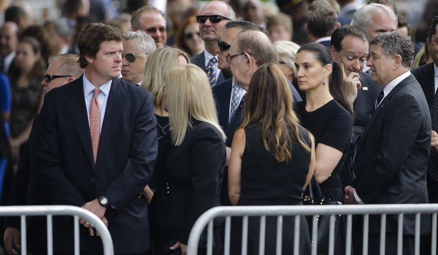 Mourners gather at St. Anthony of Padua Roman Catholic Church in Wilmington, Del., Saturday, June 6, 2015, before a funeral for former Delaware Attorney General Beau Biden. President Barack Obama will attend the funeral for Biden, the eldest son of the vice president, died of brain cancer May 30 at age 46.  (AP Photo/Matt Rourke)