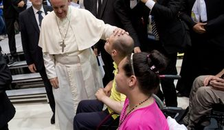 "Pope Francis caresses a boy as he arrives at the John Paul II Diocesan Youth Center, in Sarajevo, Saturday, June 6, 2015. Pope Francis witnessed the horrors of Bosnia's fratricidal war of the 1990s and its slow process of healing Saturday during a one-day visit to Sarajevo, where he urged Muslims, Orthodox and Catholics to put the ""barbarity"" of the past behind them and work together for a peaceful future. (AP Photo/Andrew Medichini)"