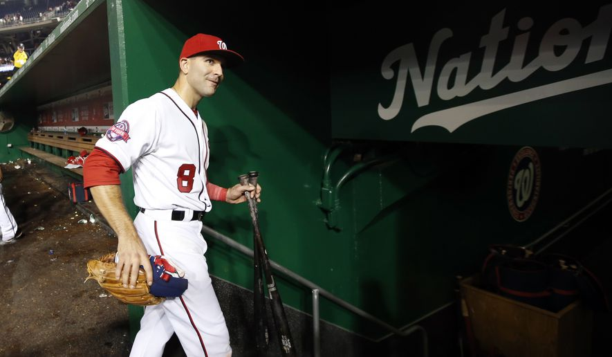 Washington Nationals second baseman Danny Espinosa (8) heads to the clubhouse after a baseball game against the Chicago Cubs at Nationals Park, Friday, June 5, 2015, in Washington. Espinosa had a three-run homer. The Nationals won 7-5. (AP Photo/Alex Brandon)