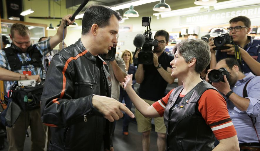 Wisconsin Gov. Scott Walker talks with Sen. Joni Ernst, R-Iowa, before riding in Ernst's fundraising ride, Saturday, June 6, 2015, in Des Moines, Iowa. (AP Photo/Charlie Neibergall)