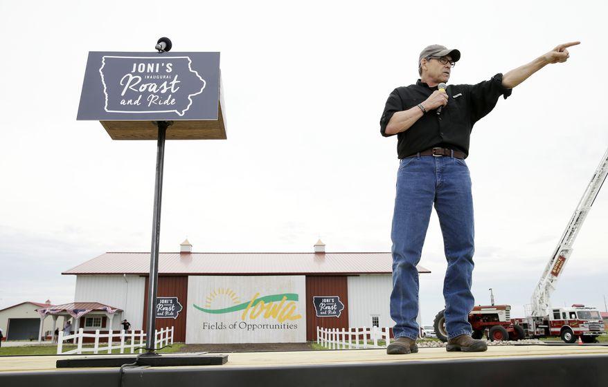 Republican presidential candidate, former Texas Gov. Rick Perry, speaks during a fundraiser for U.S. Sen. Joni Ernst, R-Iowa, Saturday, June 6, 2015, in Boone, Iowa. (AP Photo/Charlie Neibergall)