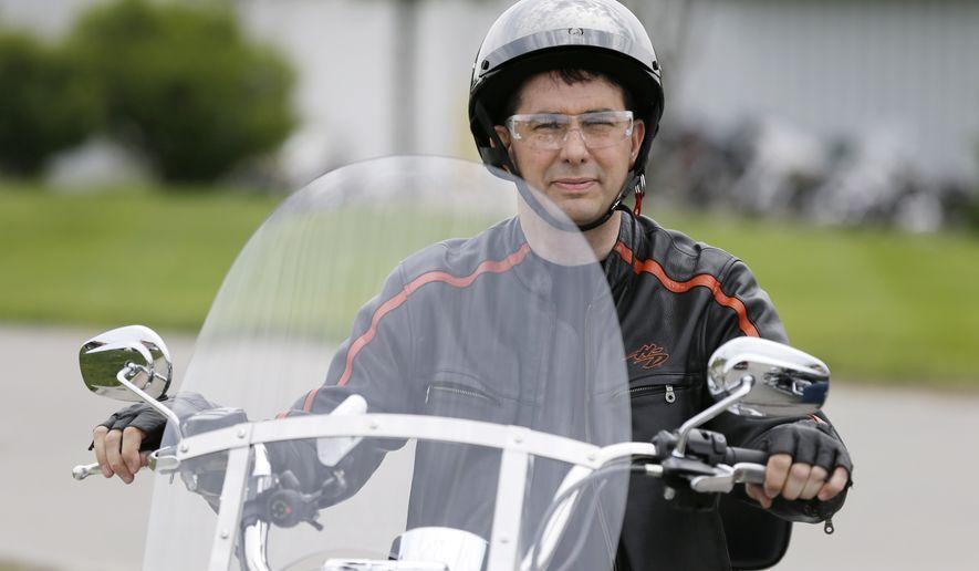 Wisconsin Gov. Scott Walker participates in a fundraising ride for Sen. Joni Ernst, R-Iowa, Saturday, June 6, 2015, in Des Moines, Iowa. (AP Photo/Charlie Neibergall)