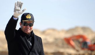 FILE - In this Sunday, Feb. 22, 2015, file photo, provided by the Egyptian Presidency, Egyptian President Abdel-Fattah el-Sissi waves during a visit to the Suez Canal in Ismailia, Egypt. A year after the general-turned-politician took office after a landslide election win, el-Sissi has effectively shut down politics and is running the country as a one-man show, a far cry from the democracy millions dreamed of when they toppled autocrat Hosni Mubarak in a stunning 2011 uprising. (Egyptian Presidency via AP, File)