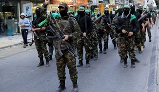 Palestinian masked militants of Izzedine al-Qassam Brigades, a military wing of Hamas, take part in a parade to mark the 11th anniversary of the Israeli assassination of Hamas spiritual leader Sheikh Ahmad Yassin in Gaza, in the northern Gaza Strip, March 23, 2015. (Associated Press) ** FILE **